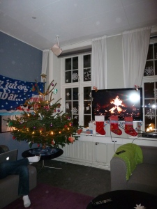 Christmas living room! Complete with Tuborg J-Day sign, Christmas tree, and fireplace TV.